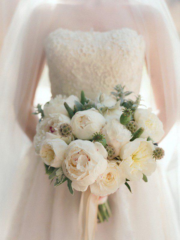 Весільні букети для нареченої: що символізують квіти у композиції